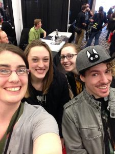 Professor Woodard with her students at  Bangor Comic and Toy Convention in April.