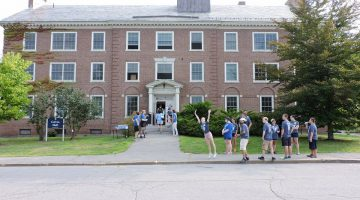 Students eagerly awaiting the arrival of new students to Colvin Hall.