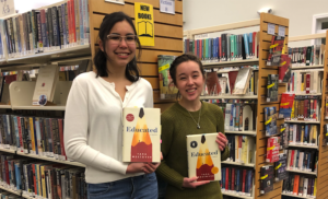 First-year Honors students Rebecca Collins and Elaine Thomas hold their copies of the book Educated in the Orono Public Library