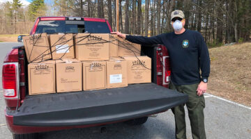 Dave Wight, a member of Blue Knights Maine Chapter 1, with meals packed for distribution through the Good Shepherd Food Bank.