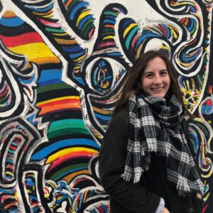 Honors student shown at the Berlin Wall while studying abroad.