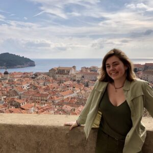 Honors student shown overlooking a city in Croatia while studying abroad.