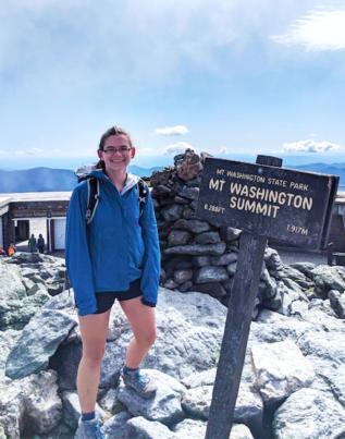 Honors Ambassador Megan Driscoll stands at the summit of Mt. Washington