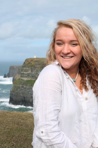 Honors Ambassador Kate Follansbee smiles at the Cliffs of Moher in Ireland
