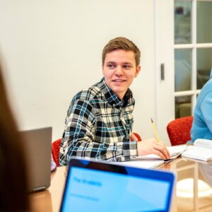 Honors students smile during a class discussion.